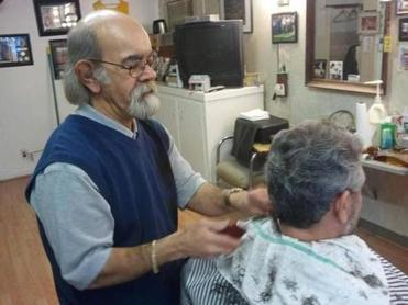 David Serpa, owner of the Barber Shoppe, will  have to find a new site  for his business when the hotel is developed.